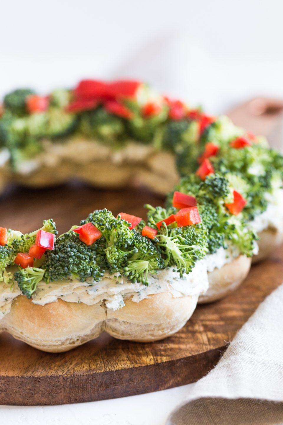Dough balls that are cooked in the shape of a wreath. Then topped with a cream cheese and ranch mixture and sprinkled with chopped broccoli and red pepper.