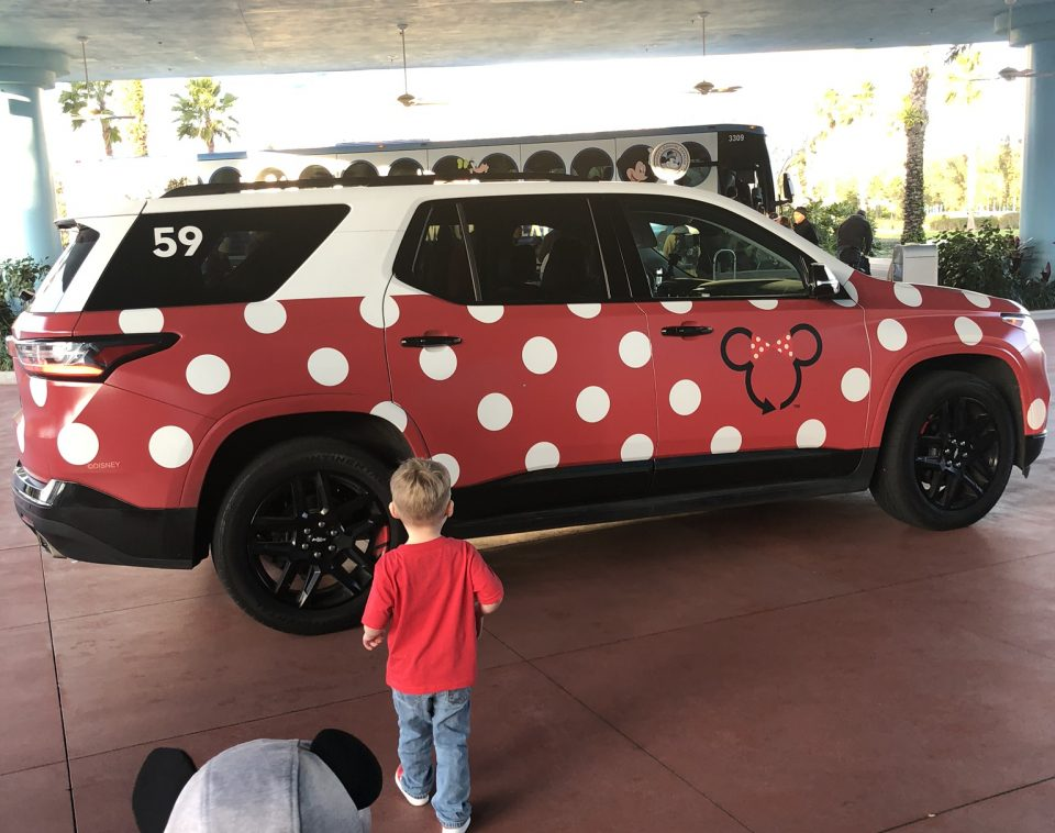 An SUV painted red with white polka dots to look like Minnie Mouse's dress.