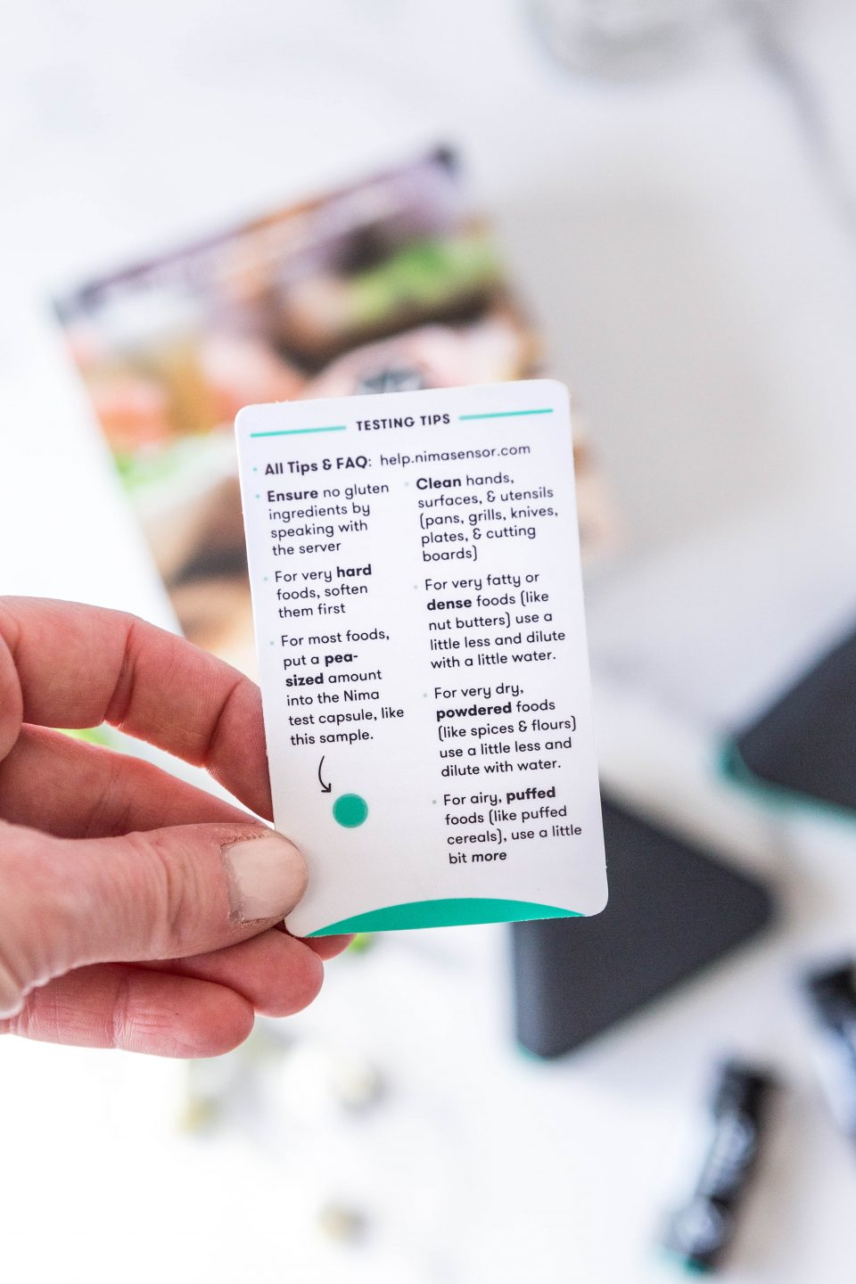Photo of a card highlighting how to test food with the Nima Gluten Sensor.