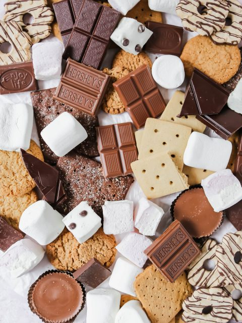 An overhead photo showing graham crackers, marshmlallows, and chocolate. The photo is messy with lots of different choices for s'mores fixings.